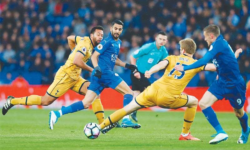 LEICESTER: Leicester City's Riyad Mahrez (second L) passes the ball to team-mate Jamie Vardy as they run through the Tottenham Hotspur defence during their English Premier League match at the King Power Stadium.—AFP