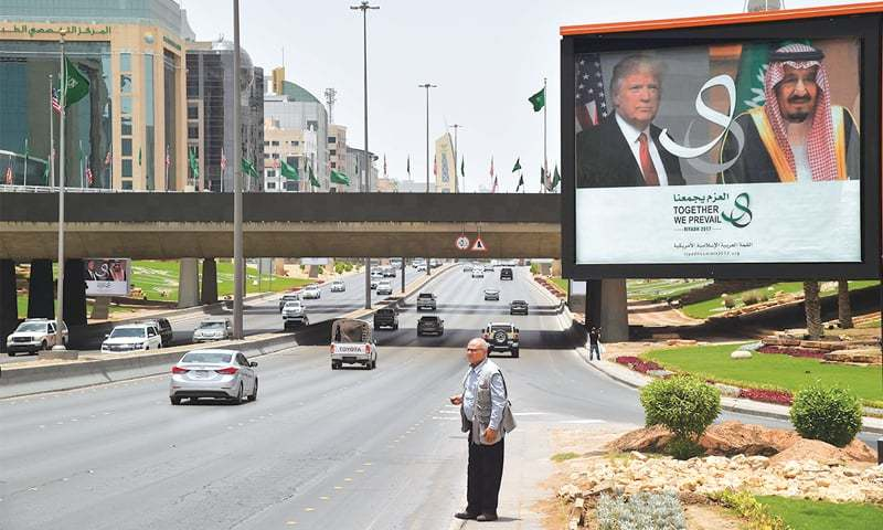 Riyadh: A giant billboard bearing portraits of US President Donald Trump and Saudi Arabia's King Salman bin Abdulaziz is seen on a main road on Friday.—AFP