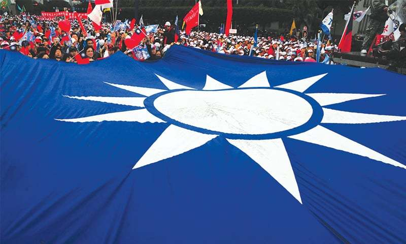 A large Kuomintang party flag is seen at a campaign rally on Jan 8, 2012 in Taipei.—AFP