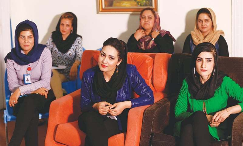 Kabul: Employees of Zan TV attend a morning meeting.—Reuters