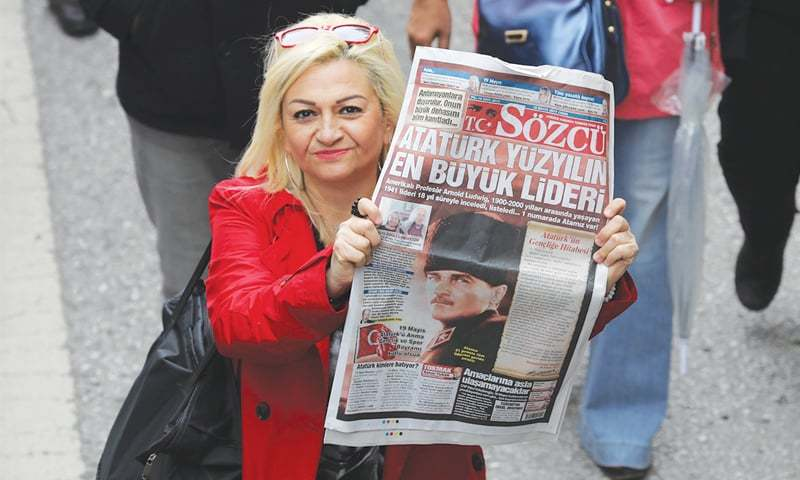 ANKARA: A woman shows a copy of Turkish opposition newspaper Sozcu after the ultra-secularist daily came under investigation by Istanbul prosecutors on Friday.—AFP