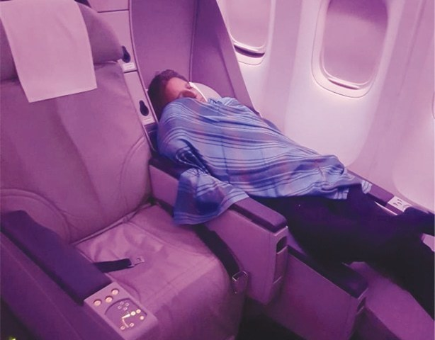 Capt Amir Hashmi catches up on his sleep in the passenger compartment.