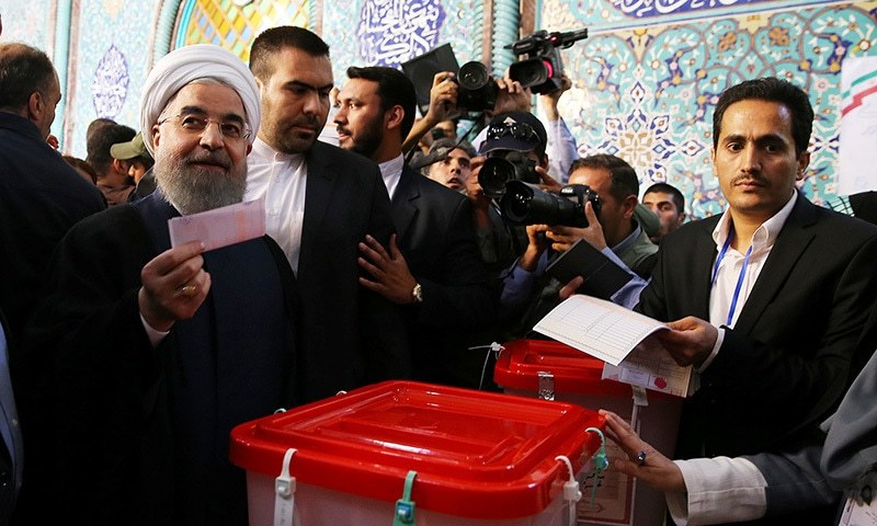 Iran's President Hassan Rouhani casts his ballot during the presidential election in Tehran, Iran, May 19. ─ Reuters