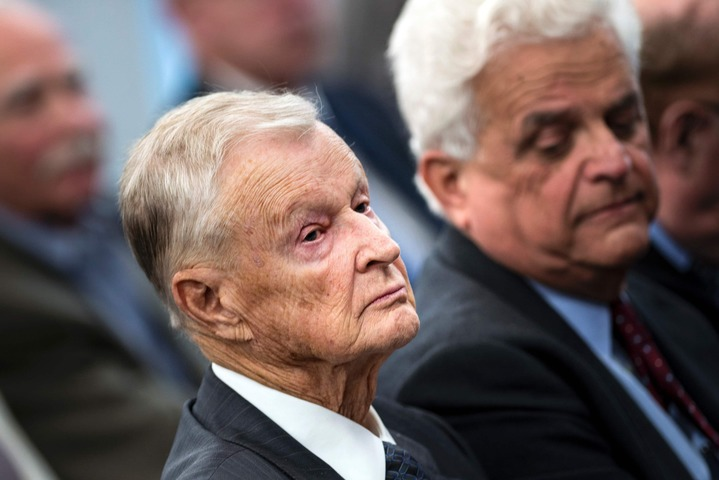 This file photo taken on October 22, 2013 shows former US National Security Adviser Zbigniew Brzezinski (L) listening during a forum discussion at the Johns Hopkins University School of Advanced International Studies in Washington, DC. — AFP