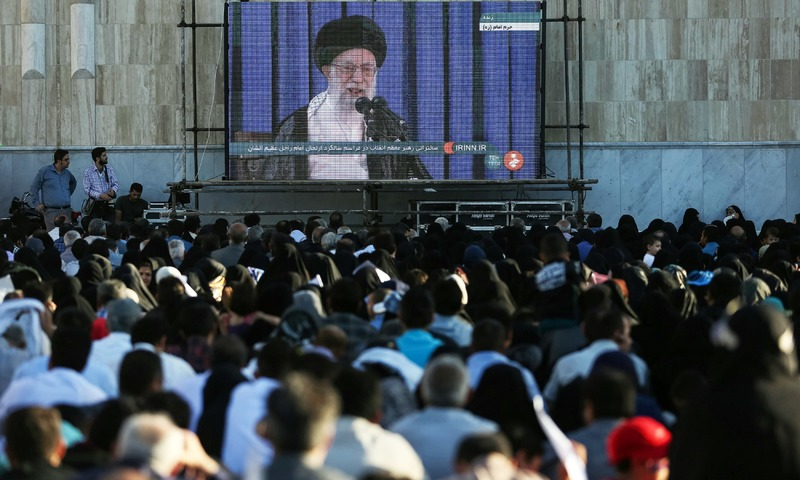 People watch on a screen Iran's Supreme Leader Ayatollah Ali Khamenei as he delivers a speech during a ceremony marking the death anniversary of the founder of the Islamic Republic Ayatollah Ruhollah Khomeini, in Tehran. —Reuters