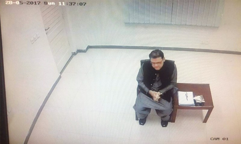 The photograph, which appears to be a screen grab from a CCTV feed, bears the date of Hussain Nawaz's first appearance before the JIT on May 28. — Dawn