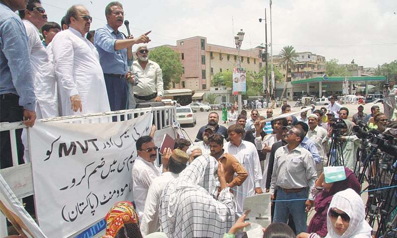 CITY Mayor Wasim Akhtar addresses councillors outside the Sindh Assembly on Friday.—PPI
