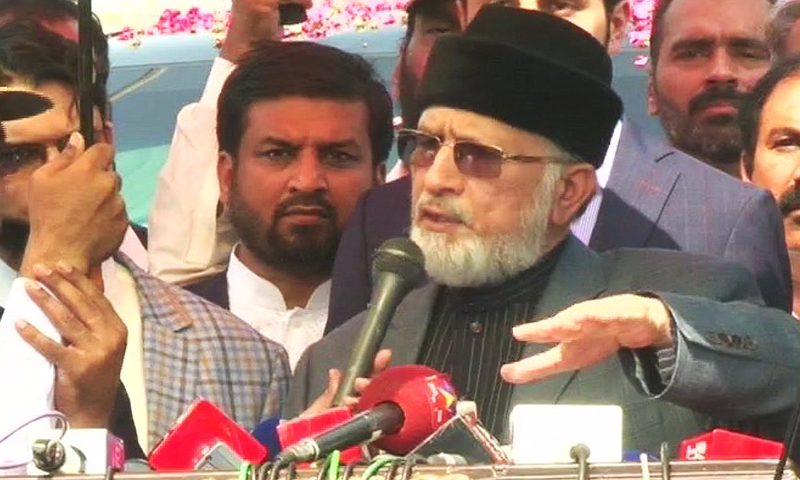 PAT chief Tahirul Qadri speaks to reporters at Lahore airport upon his return from Canada