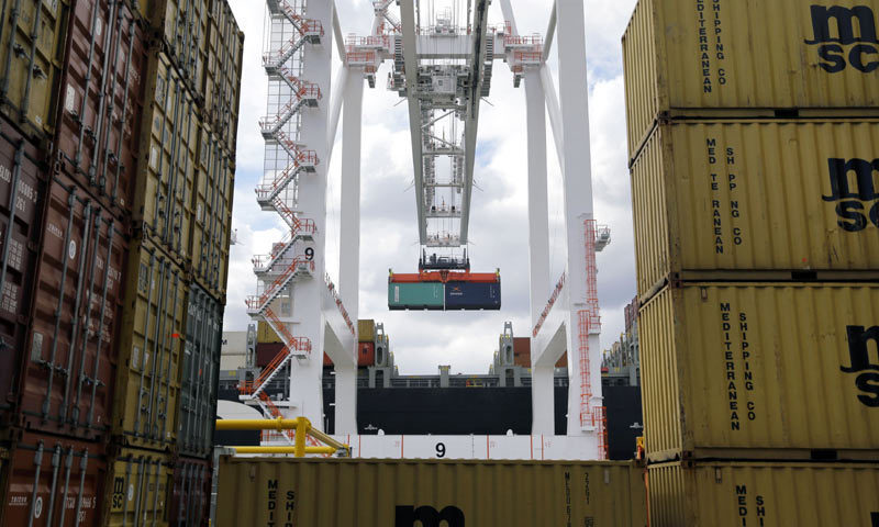 In this file photo, a crane removes a container from a ship.—AP/File