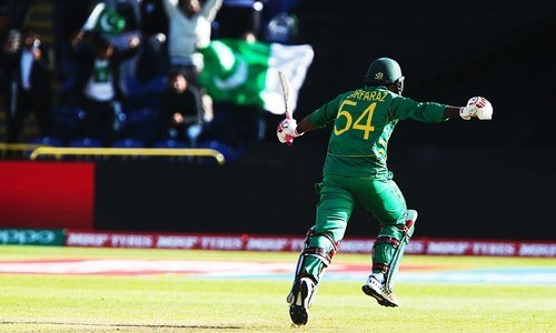 Sarfraz Ahmed celebrates after hitting the final match-winning boundary in the ICC Champions Trophy match between Sri Lanka and Pakistan.—AFP