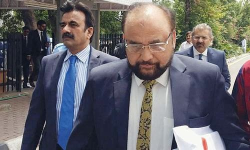 FIA additional director gen­eral Wajid Zia comes out of the Supreme Court after presenting the JIT's preliminary report on May 22.—Online/File