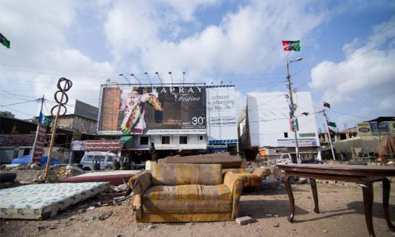 Karachi's new advertising clutter is draped in wall pastings (above) and alucobond hangings (below). The former is allowed by municipalities while the latter's legality is up for debate   Photos by Basil Andrews