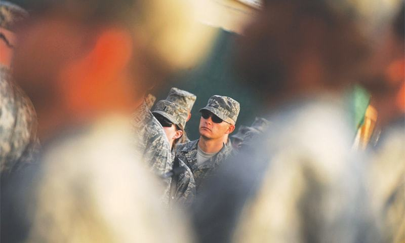 This file photo taken on Sept 11, 2008 shows US soldiers during a 9/11 remembrance ceremony at Camp Phoenix in Kabul.—AFP