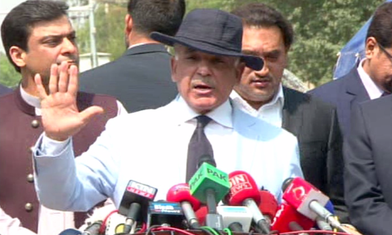Punjab Chief Minister Shahbaz Sharif speaks to the media after his JIT appearance. — DawnNews