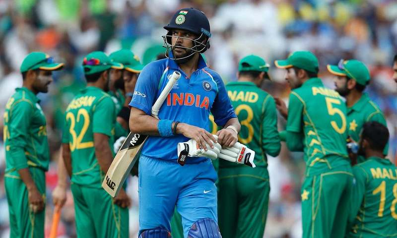 India's Yuvraj Singh walks back to the pavilion after losing his wicket. ─ AFP