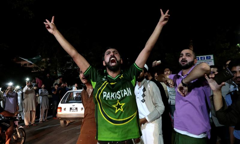Pakistani cricket fans in Islamabad cheer after Pakistan defeated India in the Champions Trophy finals. ─ Reuters