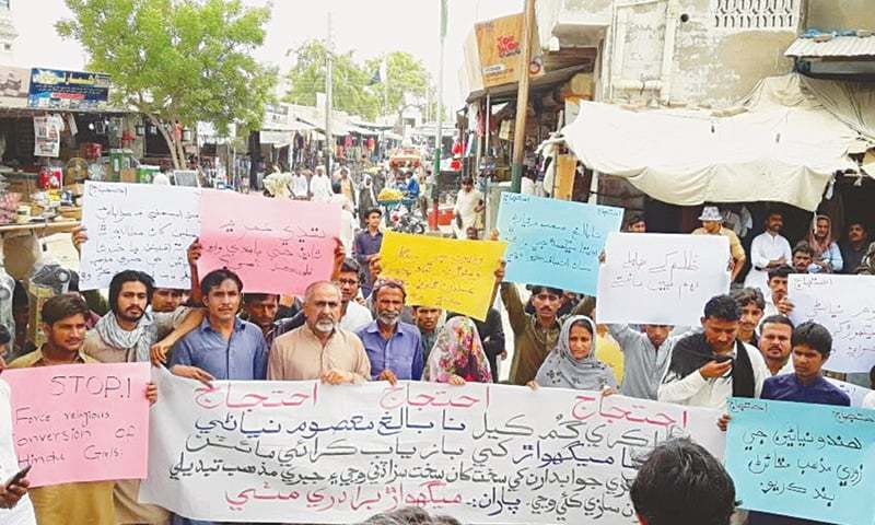 RAVITA'S mother, along with other members of her community and civil society activists, takes part in a demonstration held in Mithi on Sunday for the recovery of her 'abducted' daughter.—Dawn