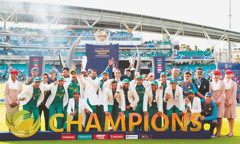 PAKISTANI players in a jubilant mood at the presentation ceremony while Mohammad Hafeez lifts the trophy.—AFP