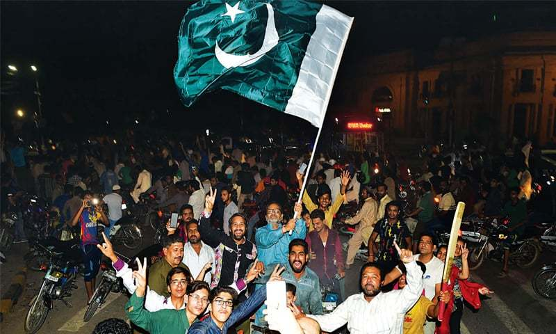 CRICKET fans hit The Mall to celebrate Pakistan's victory in the ICC Champions Trophy fi nal. — White Star/M.Arif