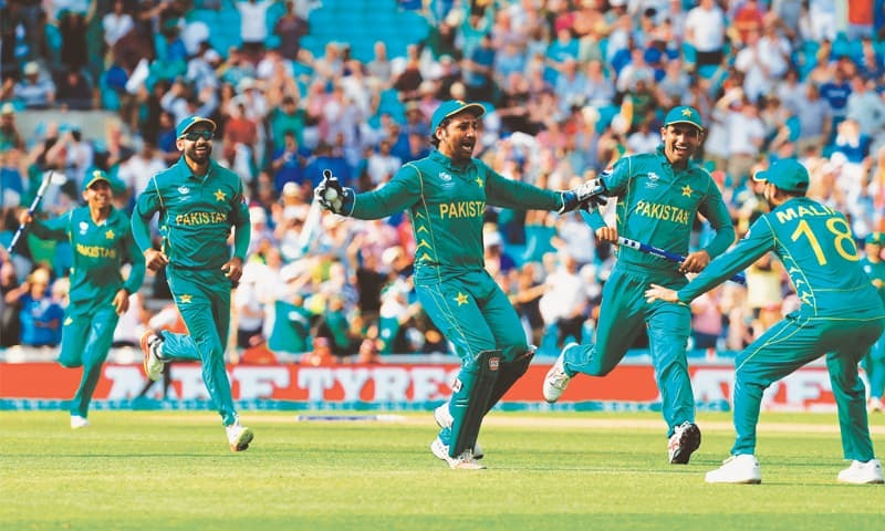 LONDON: Pakistan's Sarfraz Ahmed (centre) celebrates with teammates after taking a catch to dismiss India's last batsman.—AFP