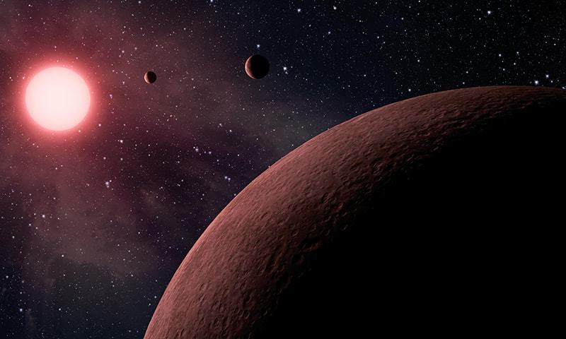 This artist rendering provided by NASA/JPL-Caltech shows some of the 219 new planet candidates, 10 of which are near-Earth size and in the habitable zone of their star identified by NASA's Kepler space telescope. ─ AP
