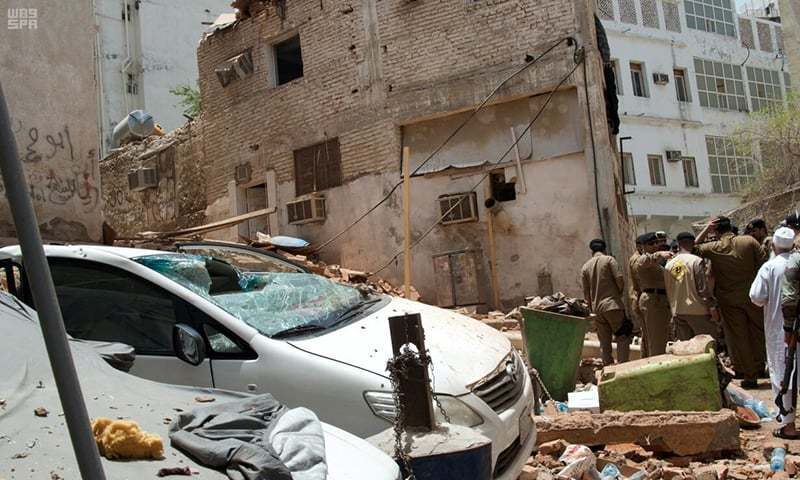 Saudi security forces work at the crime scene after a suicide bomber blew himself up in Makkah, Saudi Arabia. — Reuters