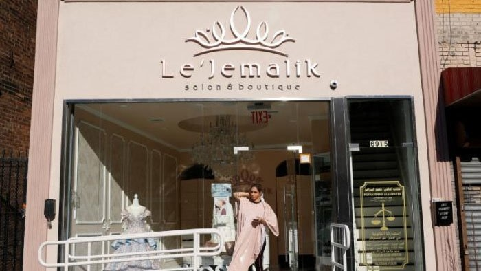 Farah Ibrahim, a 25 year old Palestinian American Muslim, stands outside Le'Jemalik Salon and Boutique after getting her hair dyed. ─Reuters