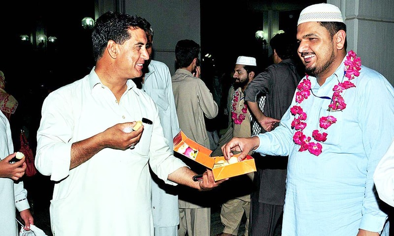 A person greets his relative who completed the 10- day aitekaf at Faisal Mosque in Islamabad. —APP