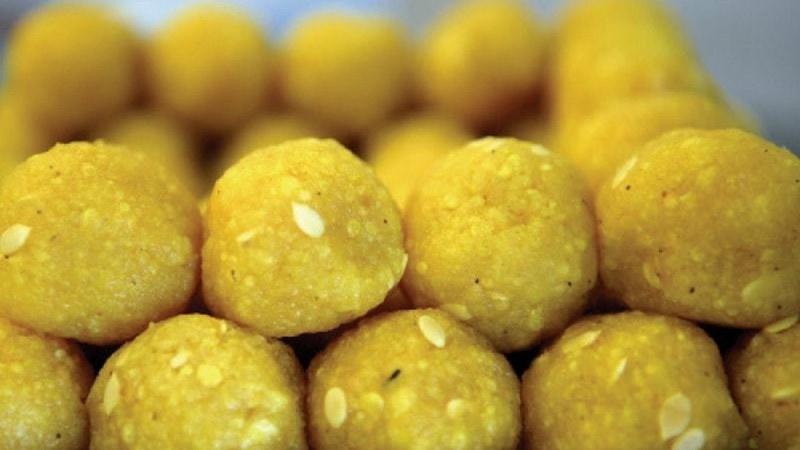 The round, yellow dessert is made from gram flour, oil, sugar, cardamom, saffron, nuts, all of which are mixed together