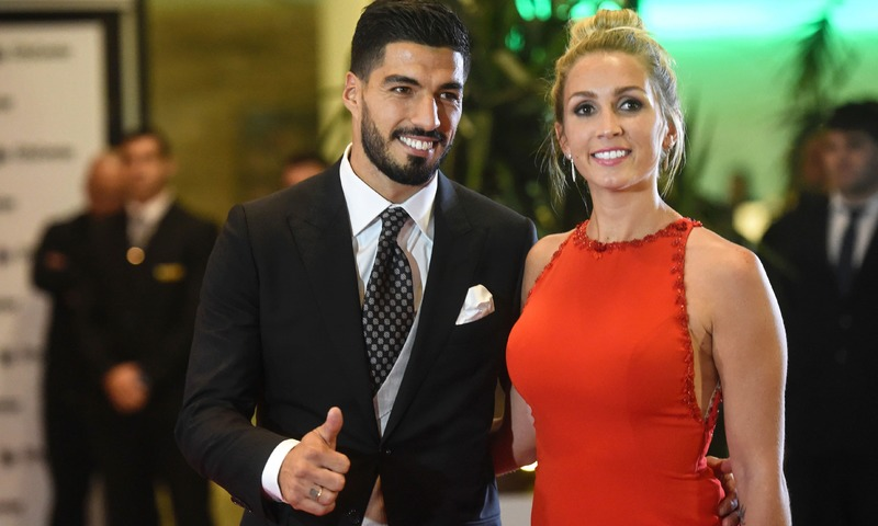 Uruguayan football player Luis Suarez and his wife Sofia Balbi pose on a red carpet during the wedding.  —AFP