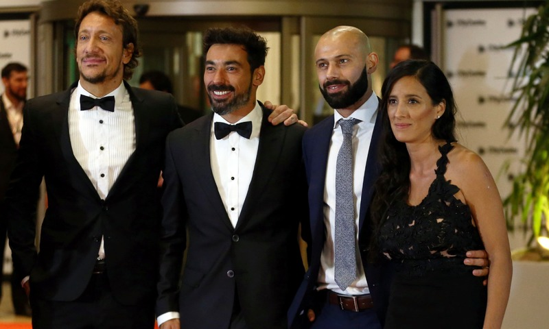 Actor Nicolas Vazquez (L) and soccer players Ezequiel Lavezzi and Javier Mascherano and his wife Fernanda pose for photographers at the wedding. — Reuters