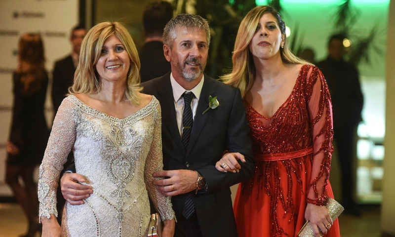 Argentine football star Lionel Messi's parents Jorge Horacio Messi (C) and Celia Maria Cuccittini and his sister Maria Sol Messi pose after Messi's wedding with Antonella Roccuzzo. —AFP