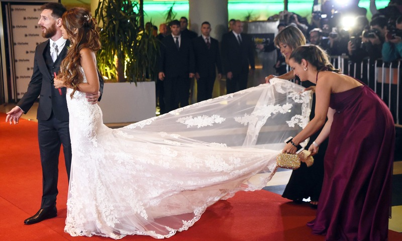 Lionel Messi and bride Antonella Roccuzzo pose for photographers just after their wedding at the City Centre Complex in Rosario. —AFP