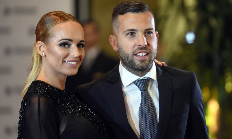 Barcelona's football player Jordi Alba and his wife pose on a red carpet during Lionel Messi and Antonella Roccuzzo wedding in Rosario. —AFP
