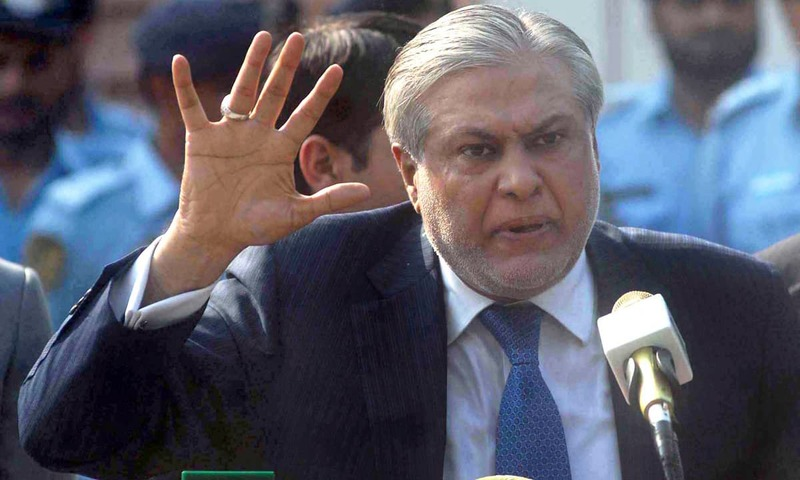 Finance Minister Ishaq Dar talking to media persons after appearing before the JIT at Federal Judicial Academy. —APP