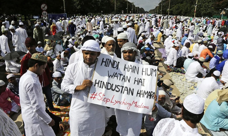 Indian Muslims hold a banner protesting recent attacks on them by Hindu fringe groups on the issue of beef eating which is taboo for Hindus as they arrive to offer Eid prayers in Kolkata. ─ AP