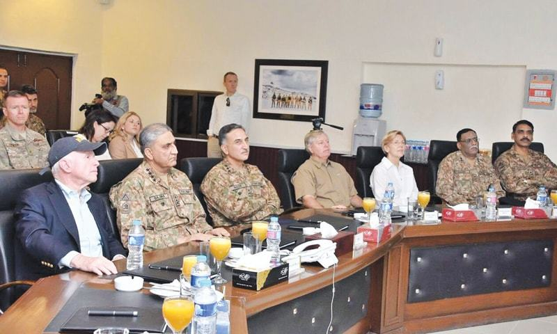 SOUTH WAZIRISTAN: Army Chief Gen Qamar Javed Bajwa, Senator John McCain and other members of the US delegation attend a briefing during their visit to South Waziristan on Monday.—INP
