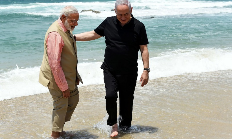 Modi and Netanyahu talk on Olga Beach in Hadera. —AFP