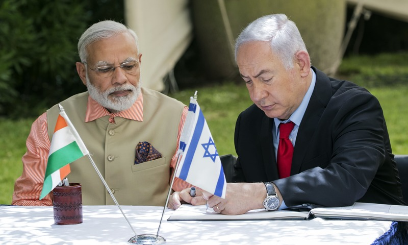 Indian Prime Minister Narendra Modi and his Israeli counterpart Benjamin Netanyahu sign the guest book at the World War I Indian Army cemetery. — AFP