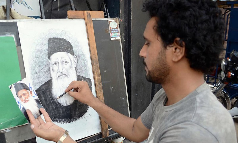 An artist giving final touch to the sketch of great philanthropist, ascetic and humanitarian Abdul Sattar Edhi at Garhi Shahu in Lahore. —Online