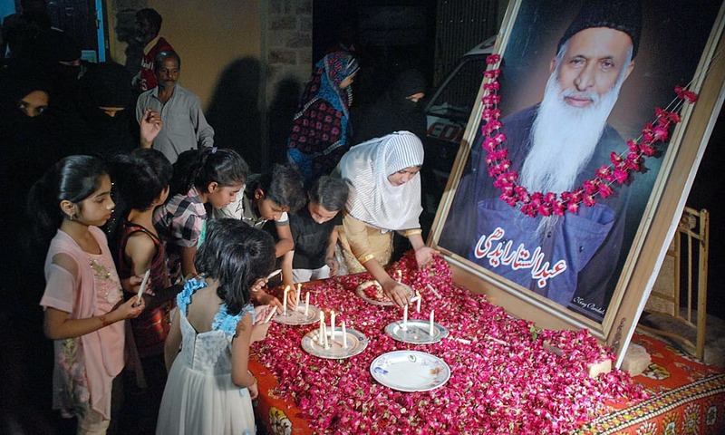 People from different walks of life lights candles at Edhi Centre in Hyderabad. —APP