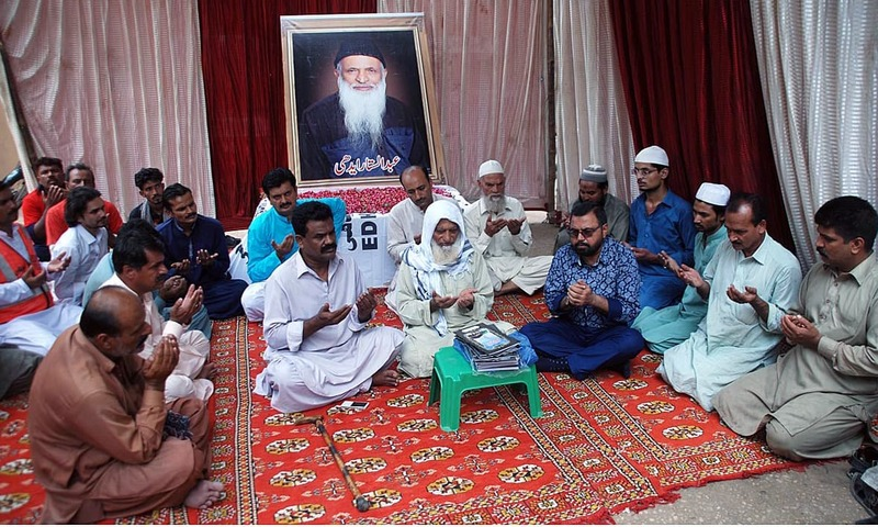 People from different walks of life hold Quran Khawani at Edhi Centre in Hyderabad. —APP