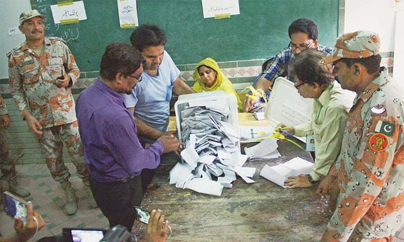 A BALLOT box is being emptied in the presence of Rangers officials at a polling station at the end of the polling time for the by-election on Sunday afternoon.—Online