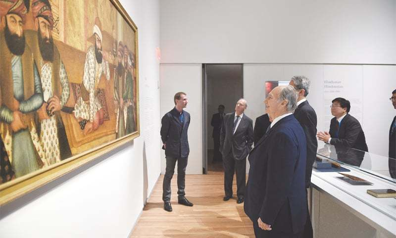 THE Aga Khan reviews a piece of Iranian art at the Aga Khan Museum in Toronto, Canada. Opened in 2014, the museum aims to foster a greater understanding and appreciation of the contribution that Muslim civilisations have made to world heritage.—AKDN / Gary Otte