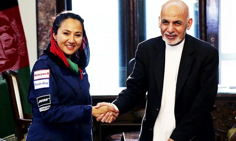 Afghan President Ashraf Ghani shakes hands with Afghan-American female pilot Shaesta Waiz at the Presidential Palace in Kabul.—AP