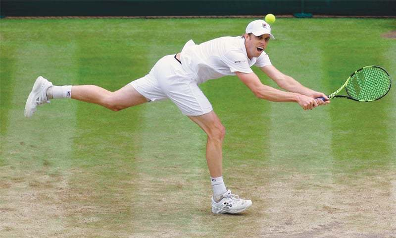 LONDON Sam Querrey of the US hits a return to Croatia's Marin Cilic during the Wimbledon semi-final on Friday.—AFP