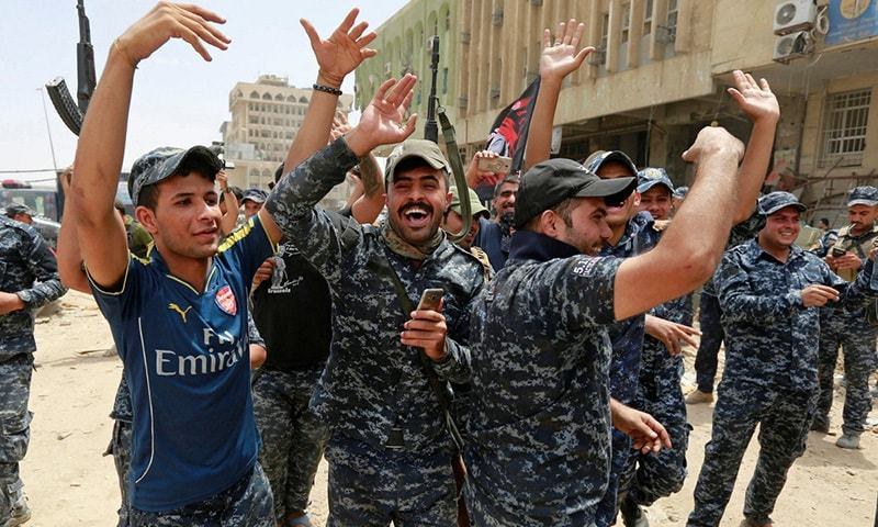 Iraqi Federal Police celebrate in Old City area on last Saturday.─Reuters/File