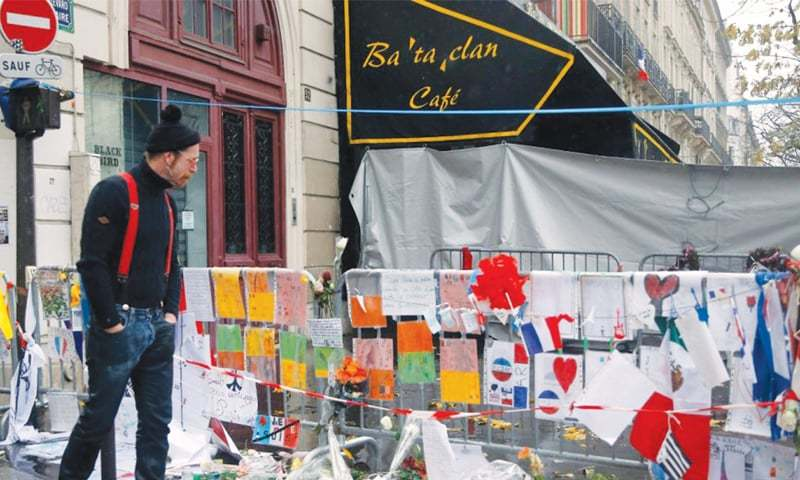 A man looks at tributes placed outside the Bataclan theatre in Paris, France. During a concert on Nov 13, 2015, three gunmen — two born in France, one in Belgium — opened fire into the crowds, killing 89. The militant group that calls itself the Islamic State claimed responsibility for the attack | AP