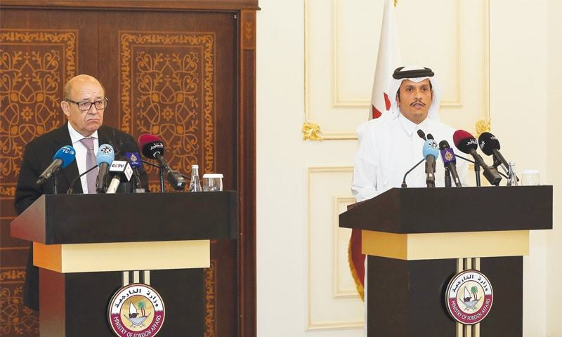 Doha: Qatari Foreign Minister Mohammed bin Abdulrahman Al-Thani (right) speaks during a press conference with his French counterpart Jean-Yves Le Drian on Saturday.—AFP