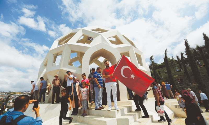 People visit the Martyrs Memorial in Istanbul on Sunday.─Reuters